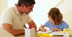 Father and daughter drawing together Stock Footage