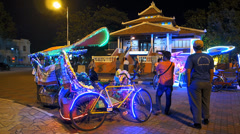 Melaka Malacca Red Square Bollywood-style tourists Bicycle Malaysia Asia Stock Footage