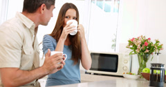 Happy couple drinking coffee together Stock Footage