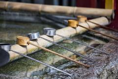 Water dipper on front of shrine Stock Photos