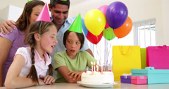 Family celebrating a birthday together Stock Footage