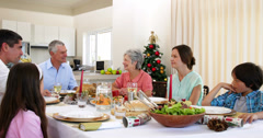 Extended family having christmas dinner together Stock Footage