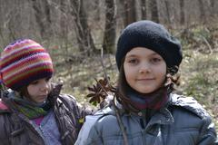 Two Little Girls In The Woods, Nature, Fun, Youth - stock photo
