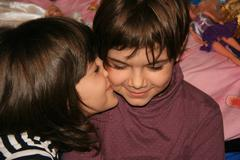 One Little Girl Kissing On The Cheek Her Best Friend - stock photo