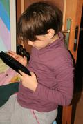 Little Girl With A Tablet PC In Her Hands - stock photo