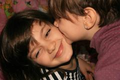 One Little Girl Kissing On The Cheek Her Best Friend Stock Photos