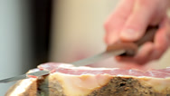 Stock Video Footage of Hands cutting slice dried ham