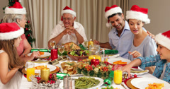 Stock Video Footage of Smiling extended family at the christmas dinner table