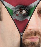 Unzipping face to flag of burundi Stock Illustration