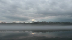 Epic nature scene of foggy river and dramatic sky in the evening (FULL HD) Stock Footage