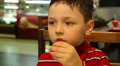 little boy eating french fries 2 Footage