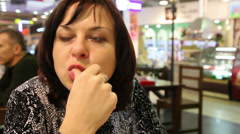 woman eating french fries - stock footage