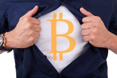 Young businessman opening his shirt and showing bitcoin currency symbol Stock Illustration