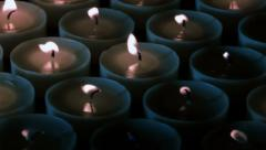 White burning candles are blown out Stock Footage