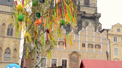 Easter markets - decorated tree with Church of Our Lady before Tyn in background Stock Footage