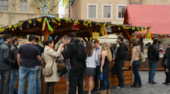 Stock Video Footage of Easter markets - exhibition of animals with people and Church in the background