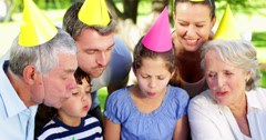 Family celebrating little girls birthday in the park Stock Footage