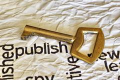 Publish and golden key Stock Photos