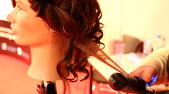 Curling mannequin hair Stock Footage