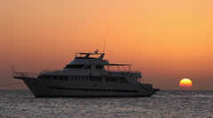 Sunrise on the sea behind a cruise boat near Hurghada, Egypt Stock Footage