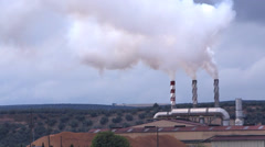 Refinery Chimneys pollute the air with smoke, pollution, Spain Stock Footage