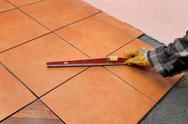 Stock Photo of home renovation, tiles and level tool