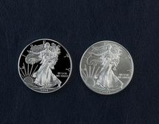 proof and uncirculated american silver eagle dollar coins - stock photo