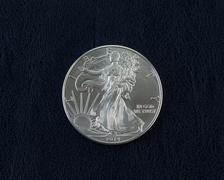 uncirculated american silver eagle dollar coin - stock photo