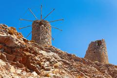 Old ruined windmills on the cret Stock Photos