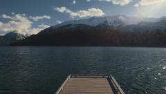 Dock on Lake with Mountains Stock Footage