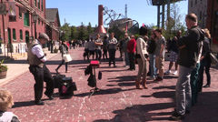 Crowds of tourists in Toronto historic distillery district Stock Footage