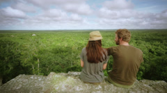 Couple on top of a mayan temple Stock Footage