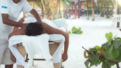 Massage at caribbean beach Stock Footage