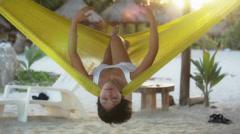Relaxing beach hammock Stock Footage