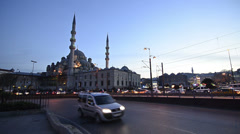 Car traffic front of New Mosque at Istanbul at evening Stock Footage