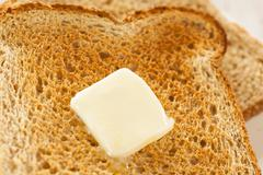 Whole wheat buttered toast Stock Photos