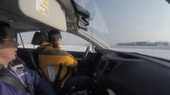 Winter training drive the vehicle. Novice driver and driving instructor Stock Footage