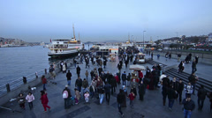 Istanbul, Eminonu, pedestrian, commuter walking, domestic ship port Stock Footage