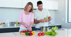 Smiling couple preparing a healthy dinner together - stock footage