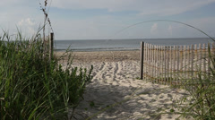 Holden Beach, NC fence and beach Stock Footage