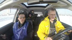 Videography test run on avtomobile.Instruktor driver and cameraman - stock footage