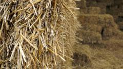 Summer breeze through Haystack in barn closeup Stock Footage