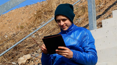 Teen with tablet PC at outdoor Stock Footage