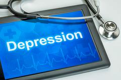 tablet with the diagnosis depression on the display - stock photo