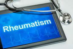 tablet with the diagnosis rheumatism on the display - stock photo