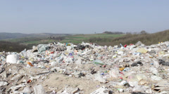 32/35 Landfill in the foreground, unspoiled nature in the background. 25fps. Stock Footage
