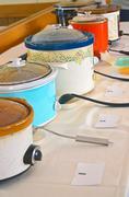 Crock pots with chili Stock Photos