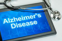 Tablet with the diagnosis alzheimer's disease on the display Stock Photos