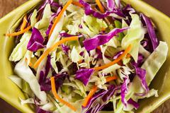 homemade coleslaw with shredded cabbage and lettuce - stock photo