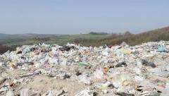 30/35 Landfill in the foreground, unspoiled nature in the background. 30fps. Stock Footage